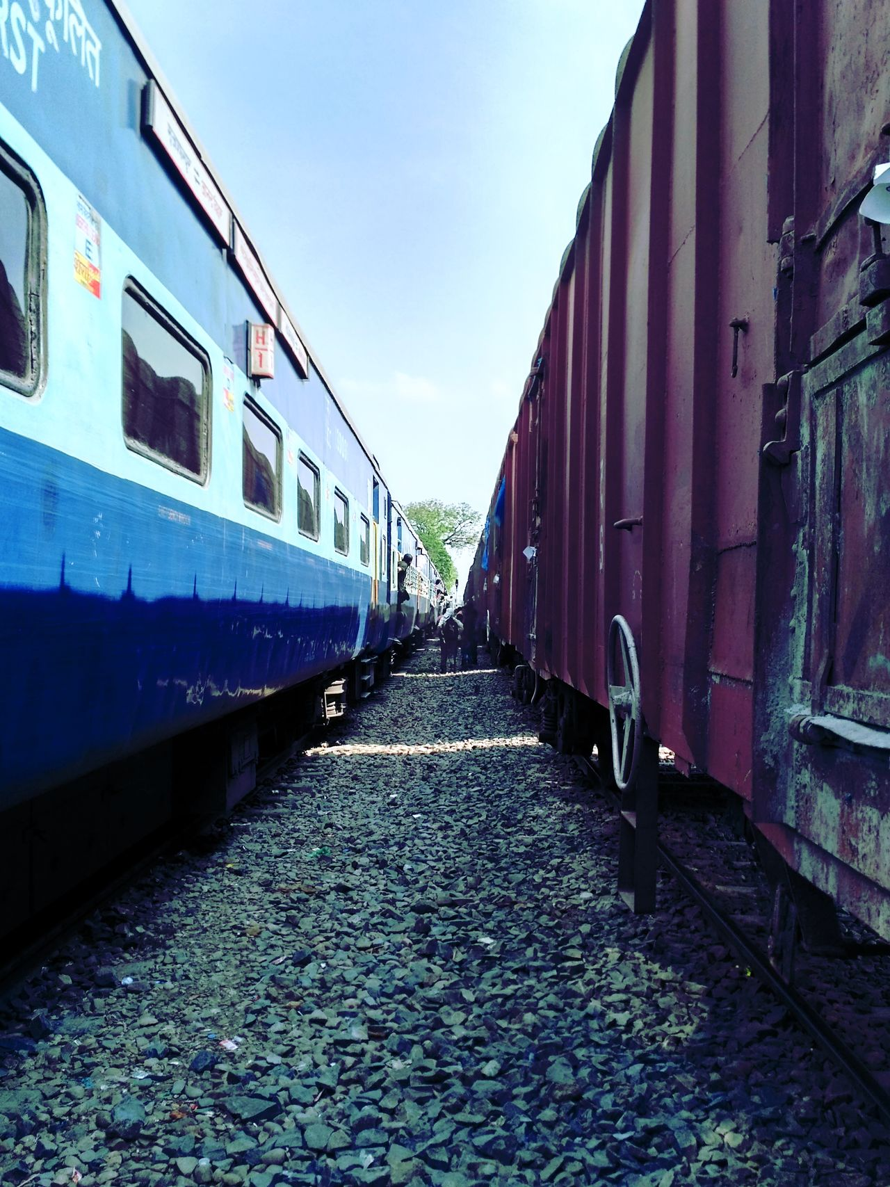 Train - Vehicle Rail Transportation Railroad Track Mode Of Transport Cargo Container Outdoors Freight Transportation Transportation Sky No People Stationary Day