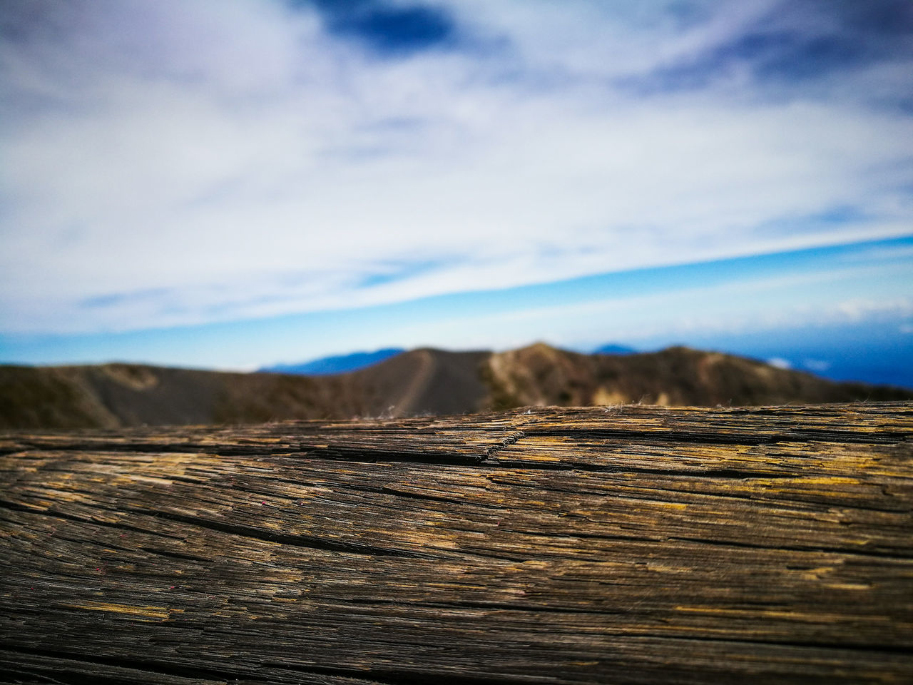 wood - material, nature, cloud - sky, sky, no people, tranquility, outdoors, beauty in nature, log, day, tranquil scene, textured, scenics, landscape, close-up