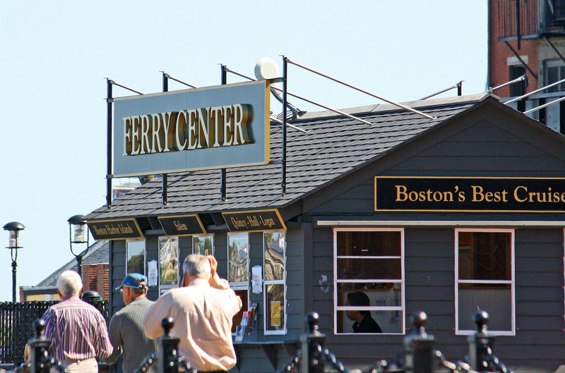 Boston Harbour Adult Architecture Boston Boat Cruises Building Exterior Built Structure City Communication Day Ferry Center Lifestyles Men Outdoors People Real People Rear View Road Sign Sky Text Walking Western Script Women