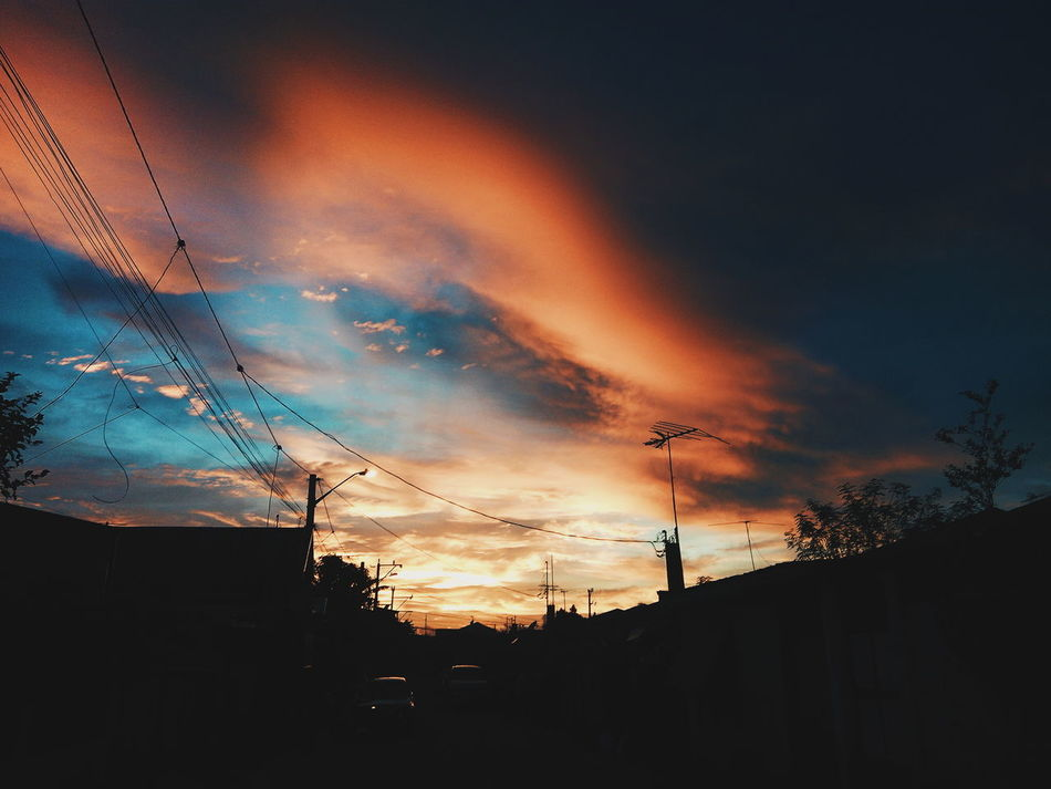 Sunset. Silhouette Low Angle View Sunset Sky Street Electricity  Dark Electricity Pylon Cloud - Sky Power Line  Cable Power Supply Cloud Outline Back Lit Outdoors Atmospheric Mood Majestic Nature Dramatic Sky First Eyeem Photo