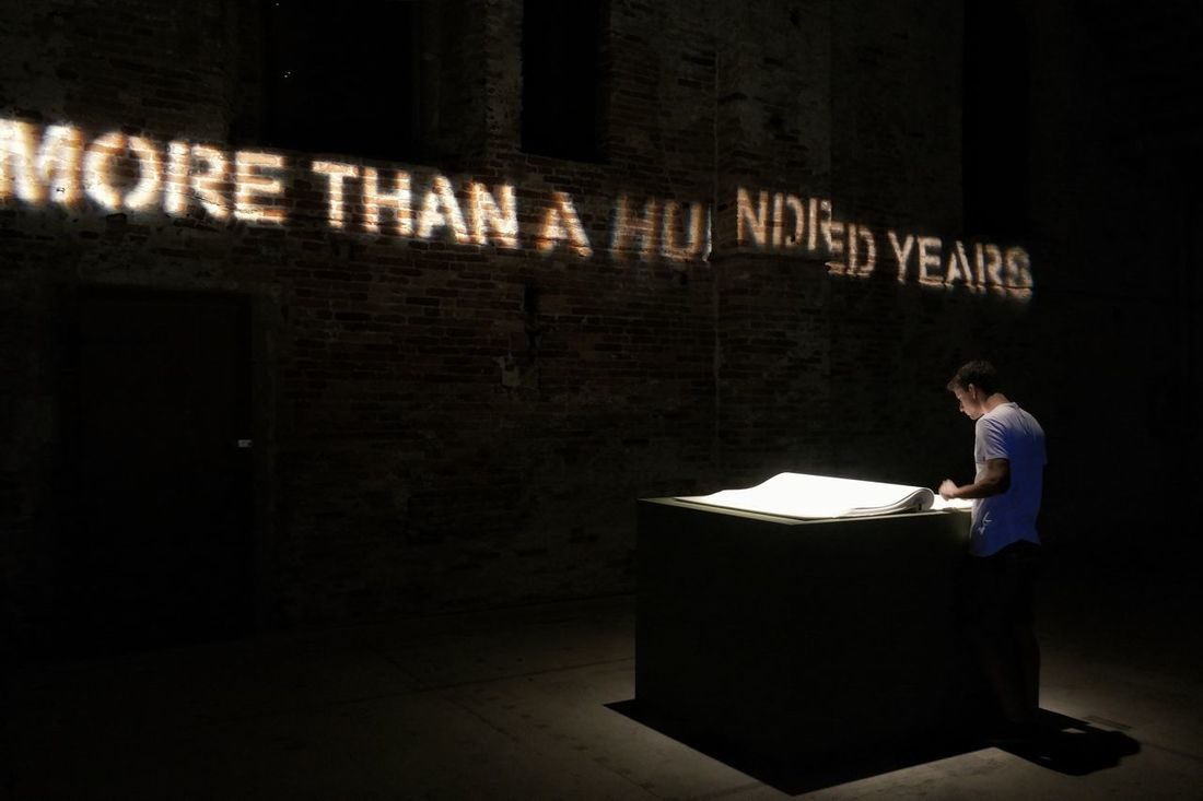 More than a 100 years from the first world war Architecture Arsenale Corderie Book Man Labiennale Architecture_collection Exposition Videoprojection Light And Shadow Darkness And Light Reading Eyyem EyeEm Best Shots