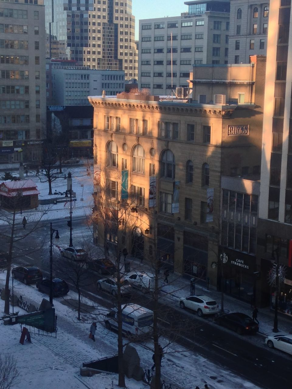 building exterior, architecture, city, snow, built structure, winter, cold temperature, cityscape, outdoors, street, city life, no people, road, skyscraper, day, nature