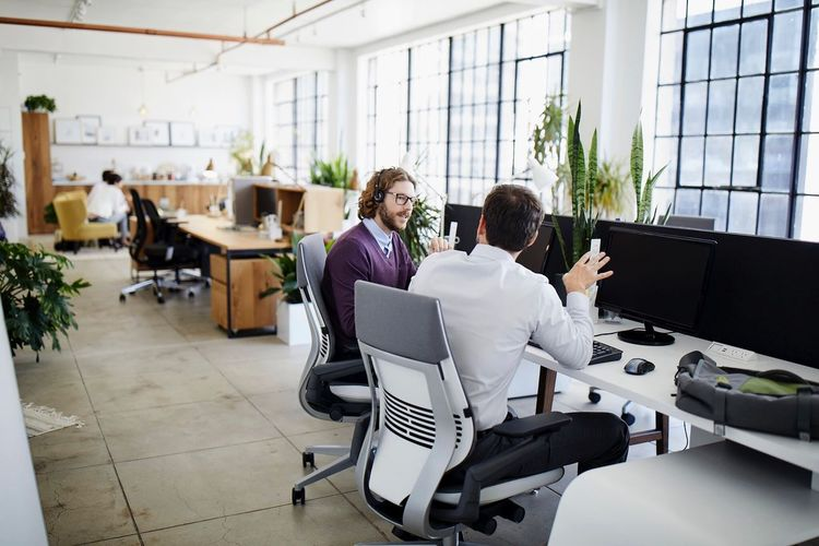 Workplace in San Francisco . Teamwork Indoors  Sitting Office Colleague Coworker Mature Adult Adults Only Technology Business Adult Working Cooperation Businesswoman Togetherness Young Adult Connection Discussion Chair Businessman