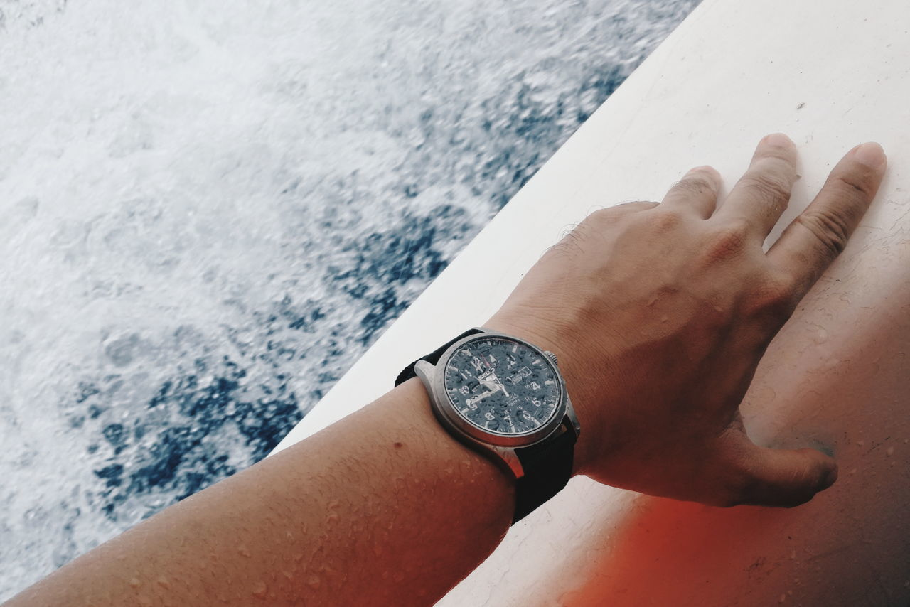 Wet Human Body Part One Person Sea Leisure Activity People High Angle View Water Close-up Lifestyles Human Hand Watch Outdoor Boating