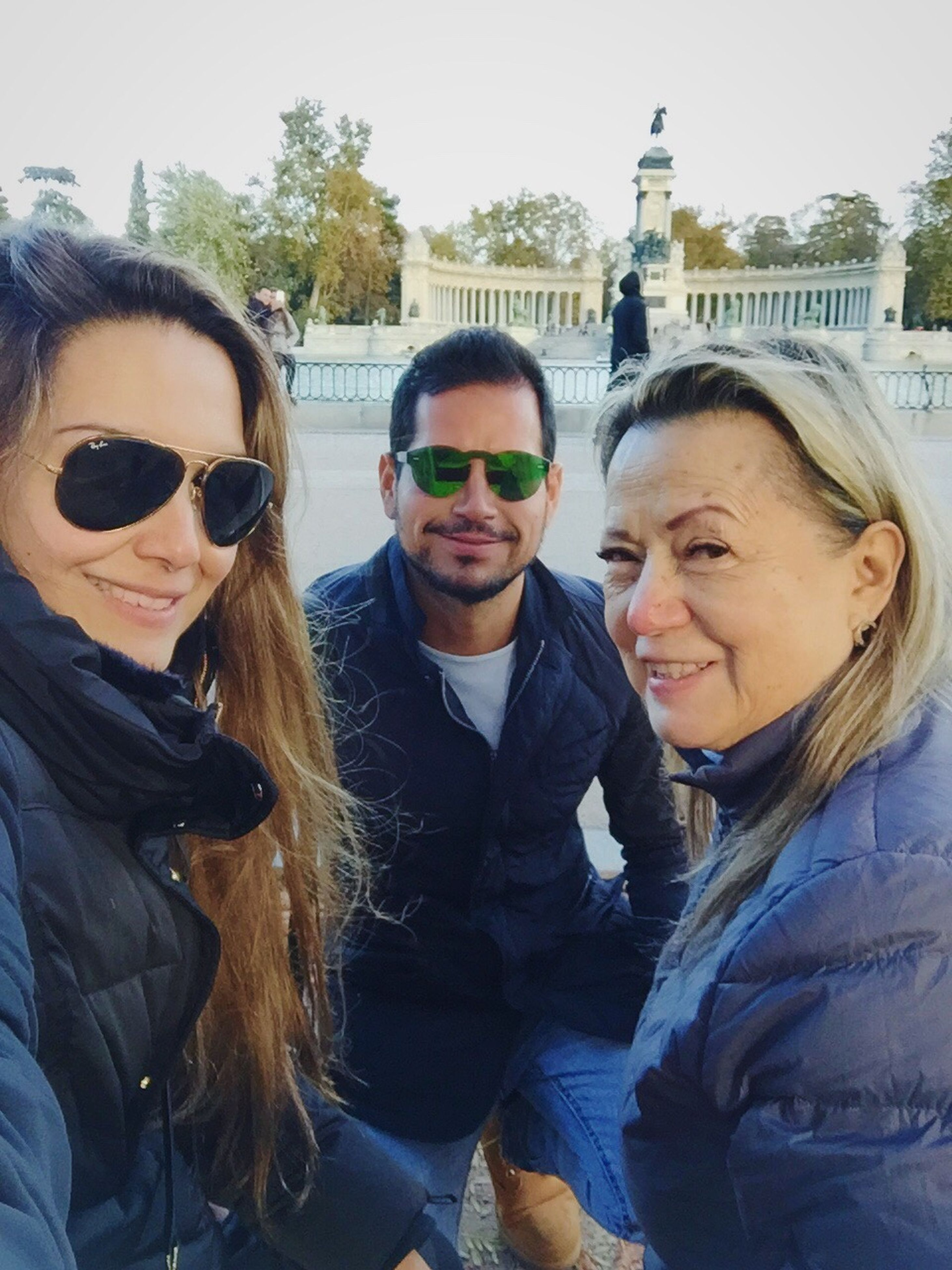 sunglasses, young adult, city, young women, friendship, women, adults only, adult, people, built structure, togetherness, warm clothing, outdoors, architecture, smiling, day, well-dressed