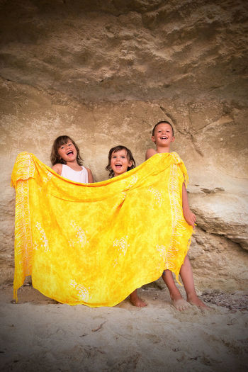 Kid's song behind the yellow shelter. Happy Kids Paint The Town Yellow Singing Bonding Children Singing Friendship Happiness Kids Sing Shelter Smiling Song Togetherness Yellow Yellow Cover Yellow Scarf  Yellow Shelter