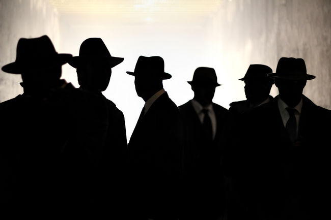 Several men in suits and hats in silhouette. Concept for security, privacy and surveillance. Agency Communication Concept Conceptual Crime Fedora  Film Noir Gangster Government Hacking Internet Security Men Men In Black People Watching Privacy Secret Security Shadow Spy Spying Streetphotography Suits  Surveillance Watcher Watching