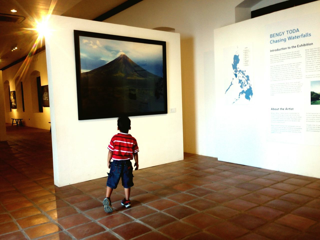 rear view, real people, one person, indoors, boys, museum, leisure activity, full length, childhood, standing, day, people