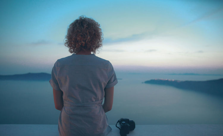 Blue Camera People Of The Oceans The Following Coastline Dusk Escapism Getting Away From It All Island Photographer The Great Outdoors - 2016 EyeEm Awards Santorini Sea Sitting Sky Standing Waiting Young Adult Young Women Women Who Inspire You Blue Wave People And Places Dramatic Angles Breathing Space Done That. Been There. Done That. Be. Ready. EyeEm Ready   An Eye For Travel