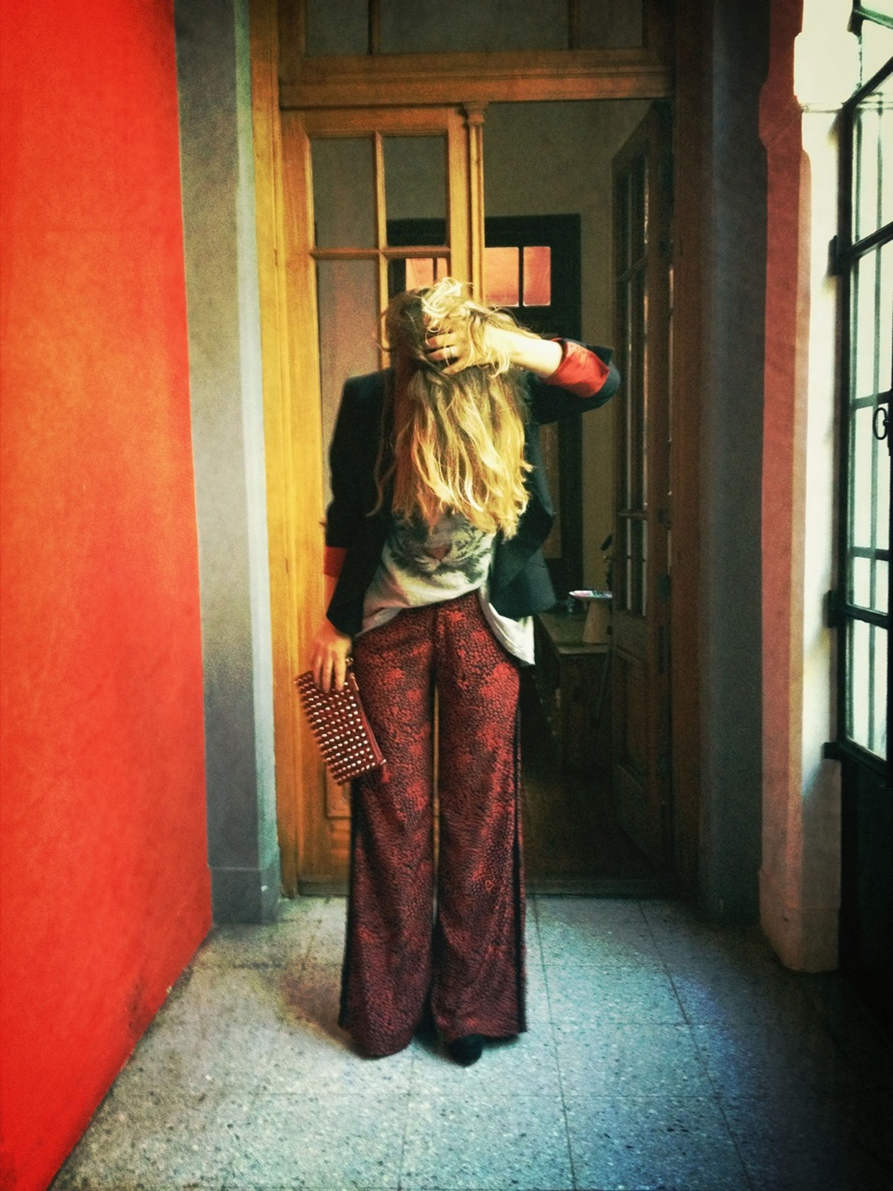 full length, red, rear view, architecture, standing, built structure, lifestyles, casual clothing, leisure activity, building exterior, indoors, person, young women, long hair, walking, traditional clothing, front view, door
