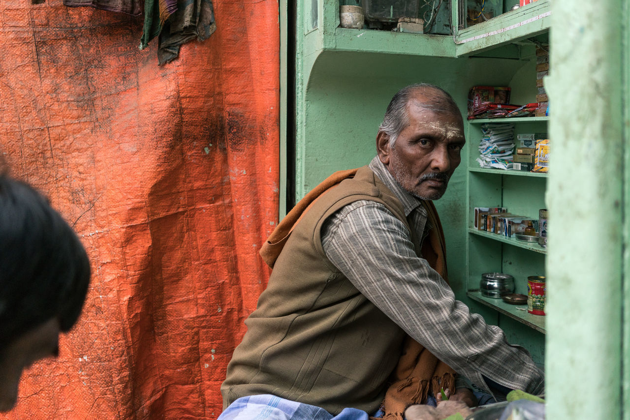 Street Vendor, Varanasi Color Color Palette Colorful Colours India India_clicks Indian Culture  Indianstories Indiapictures Man Mature Adult One Person Portrait Real Life Real People Real People Photography Real People, Real Lives Street Photography Streetphotography Travel Travel Destinations Travel Photography Varanasi Varanasi India Varanasi, India Ganges, Indian Lifestyle And Culture, Bathing In The Ganges,