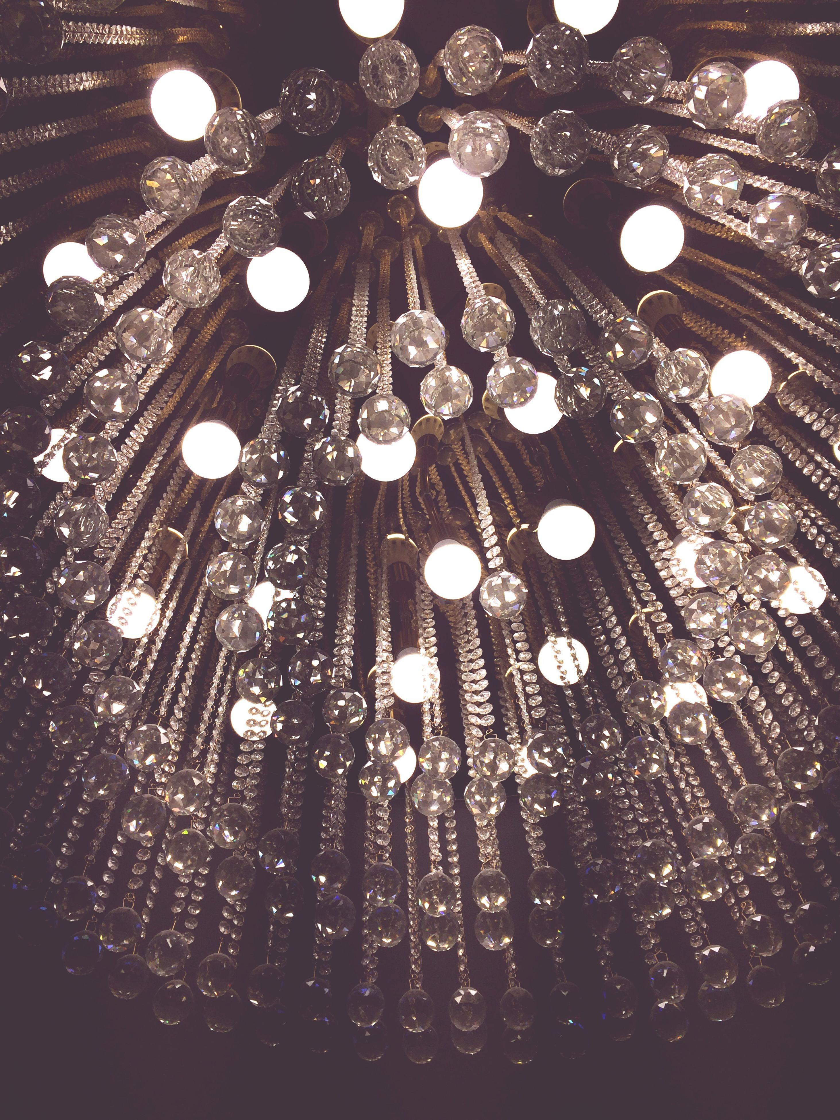 illuminated, indoors, low angle view, lighting equipment, celebration, night, ceiling, decoration, hanging, chandelier, arts culture and entertainment, glowing, light - natural phenomenon, christmas lights, decor, electric light, pattern, design, christmas decoration, electricity