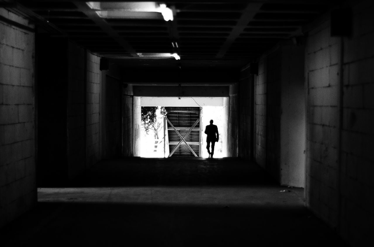 - under the bridge -Architecture Black & White Black And White Blackandwhite Blackandwhite Photography Built Structure Cleaning Day EyeEm EyeEm Best Edits EyeEm Best Shots EyeEm Gallery EyeEmBestPics Full Length Indoors  Lifestyles Men One Person Real People Rear View Silhouette Sunlight The Way Forward Tunnel Walking