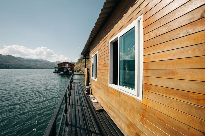 Adventure Architecture Building Exterior Built Structure Cruise Day Destination Floating House Idyllic Lake Mountain Nature No People Outdoors Rafting Scenics Sky Travel Destinations Variation Water Window