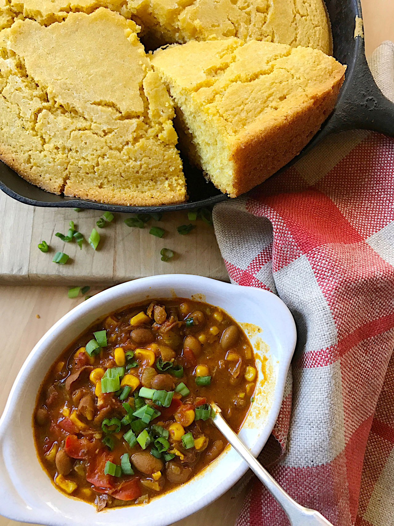 American Food Bowl Cast Iron Skillet Chili  Colorful Cornbread Cutting Board Day Dinner Home Cooking Indoors  Lunch Meal Meal Napkin Natural Light No People Phone Camera Red Savory Food Spoon Supper Textures Wood Surface Yellow