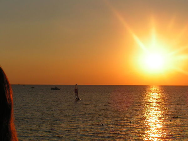 Beauty In Nature Horizon Over Water Outdoors Sea Sun Sunbeam Sunset Waterfront