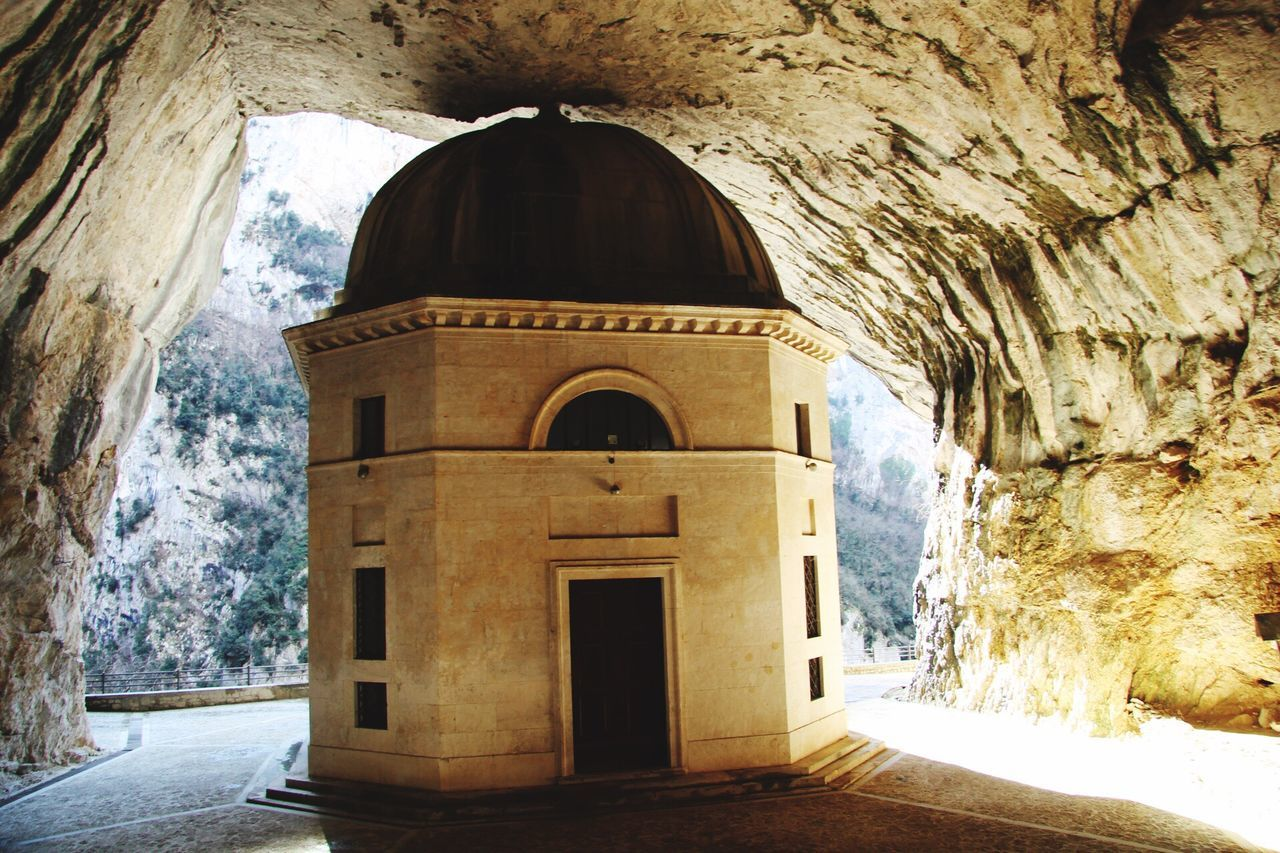 arch, architecture, built structure, indoors, history, day, cave, place of worship, travel destinations, rock - object, religion, spirituality, ancient, no people, natural arch, nature, beauty in nature, sky