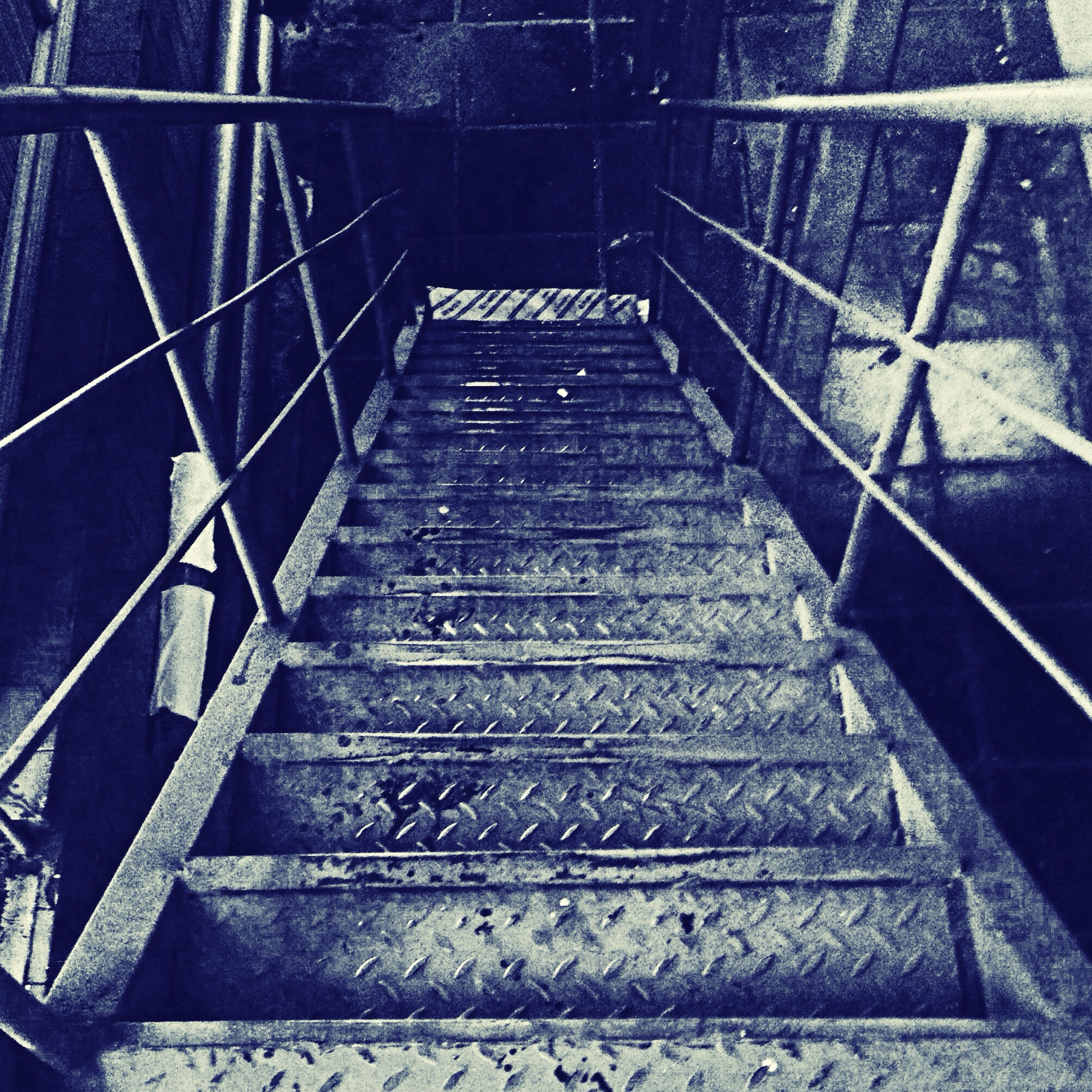 steps and staircases, steps, staircase, railing, metal, the way forward, low angle view, built structure, architecture, stairs, diminishing perspective, connection, high angle view, metallic, no people, day, vanishing point, old, outdoors