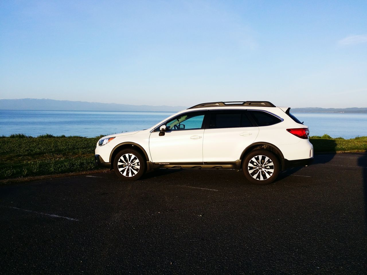 car, transportation, road, land vehicle, day, no people, sea, blue, sky, horizon over water, nature, outdoors, water