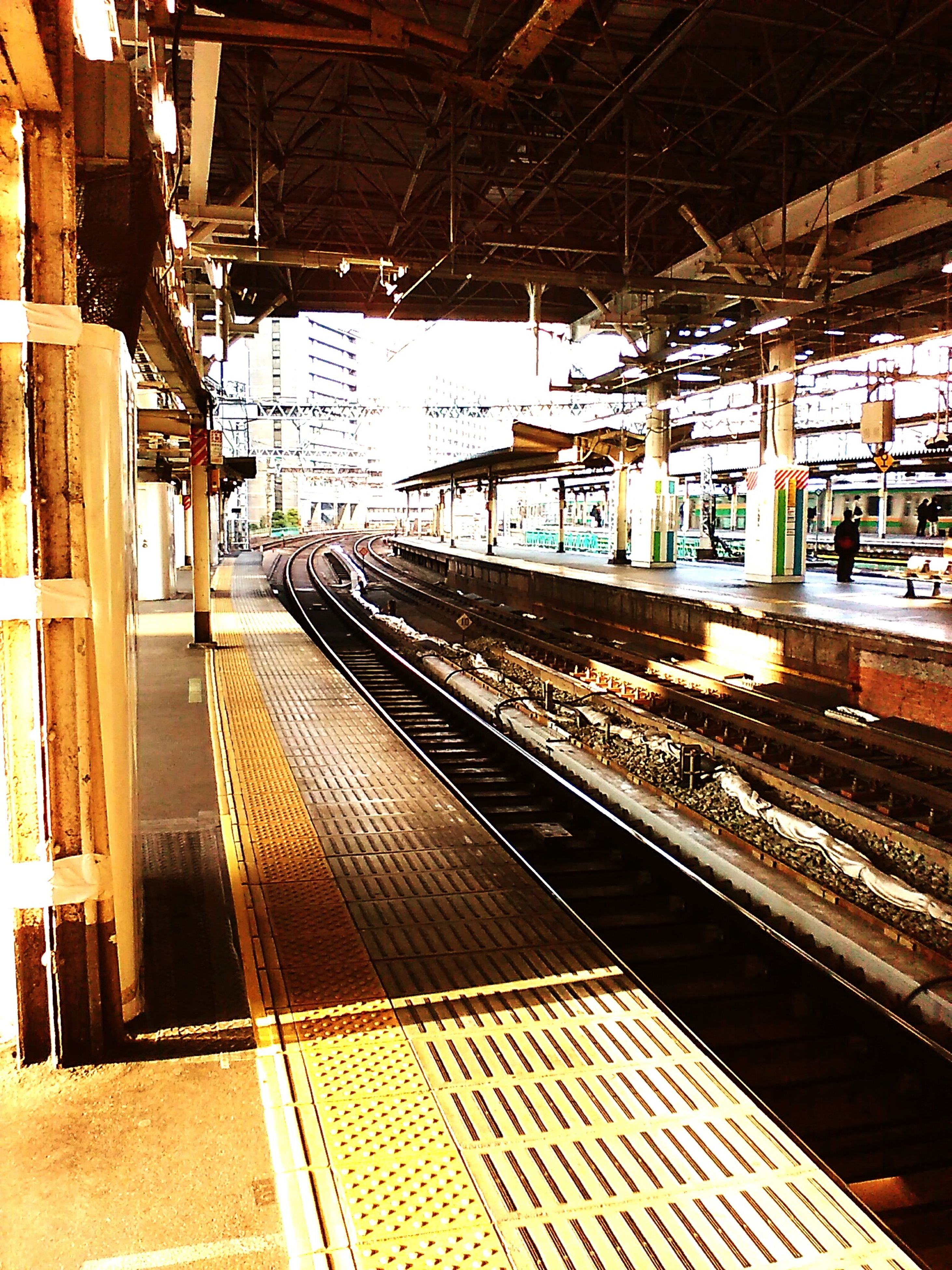 railroad track, transportation, rail transportation, public transportation, railroad station platform, railroad station, train - vehicle, indoors, mode of transport, built structure, travel, train, passenger train, public transport, architecture, illuminated, railway track, the way forward, diminishing perspective, high angle view