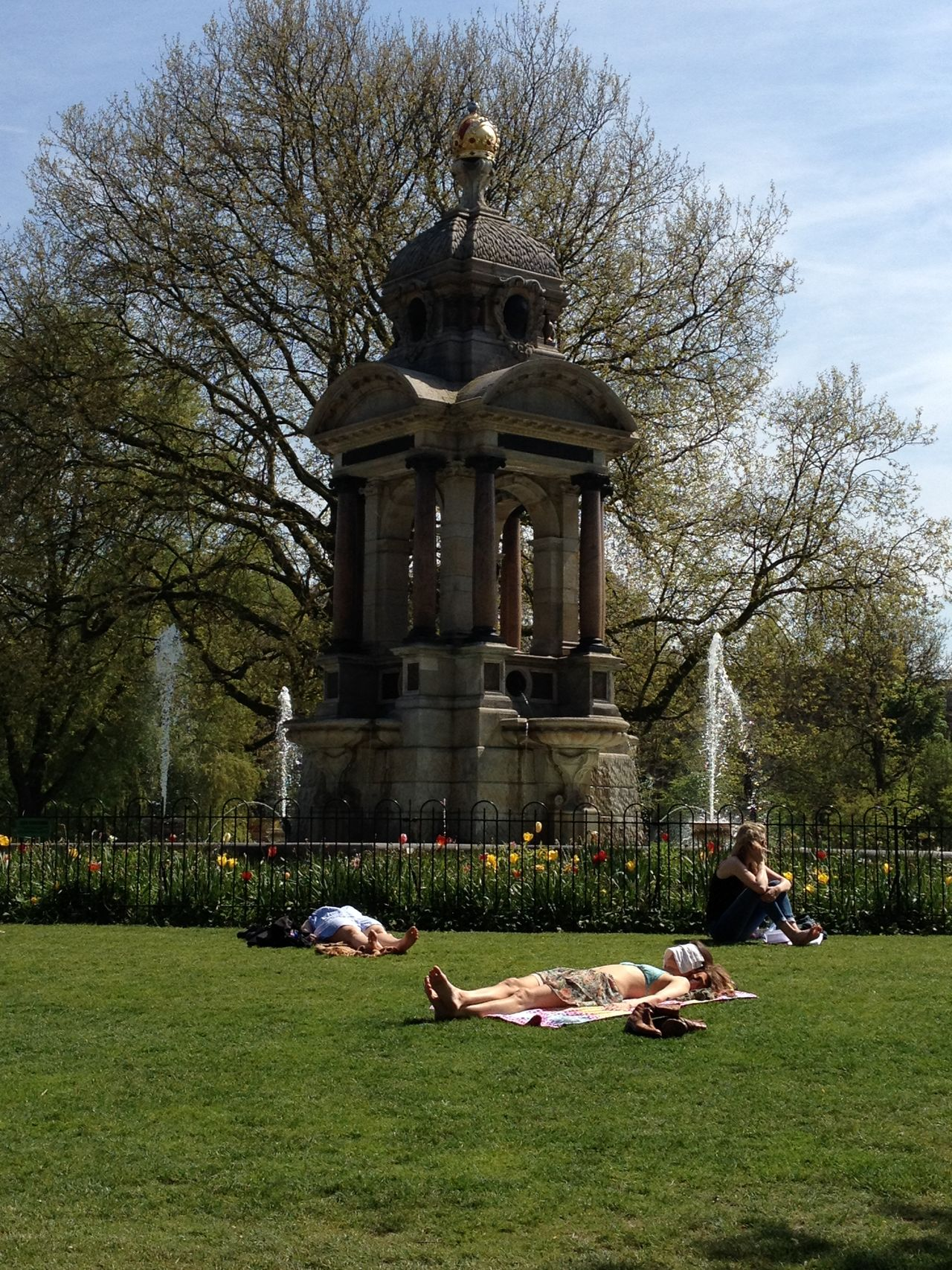 Summer In The City Three Girls Sunbathing In The Park Sarphatipark Amsterdam Netherlands Sunny Day Water Fountain Lying Down Talking On The Phone Grass Outdoors Urban Lifestyle The Essence Of Summer