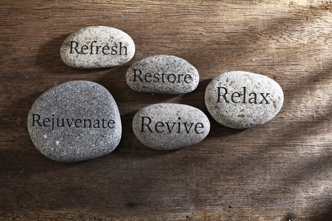 pebble or stone with inspiration text Carved Concept Create Engraved Inspiration No People Nobody People Quotes Refreshment Rejuvenate Relax Restore Revival Rock Sign Stone Symbols Text Wooden Background Working Zen