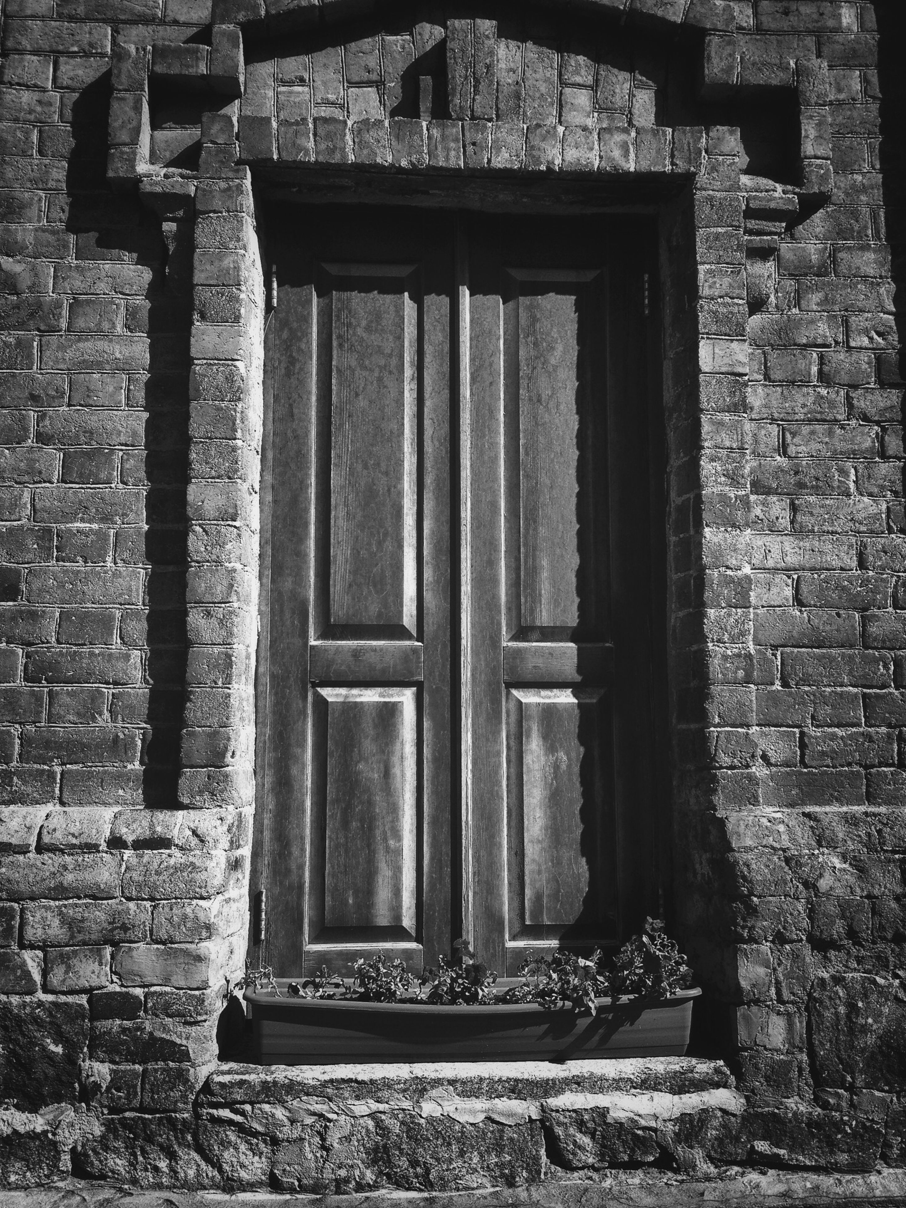building exterior, architecture, built structure, window, brick wall, house, door, closed, old, entrance, wall - building feature, residential structure, stone wall, residential building, weathered, wall, outdoors, day, facade, no people