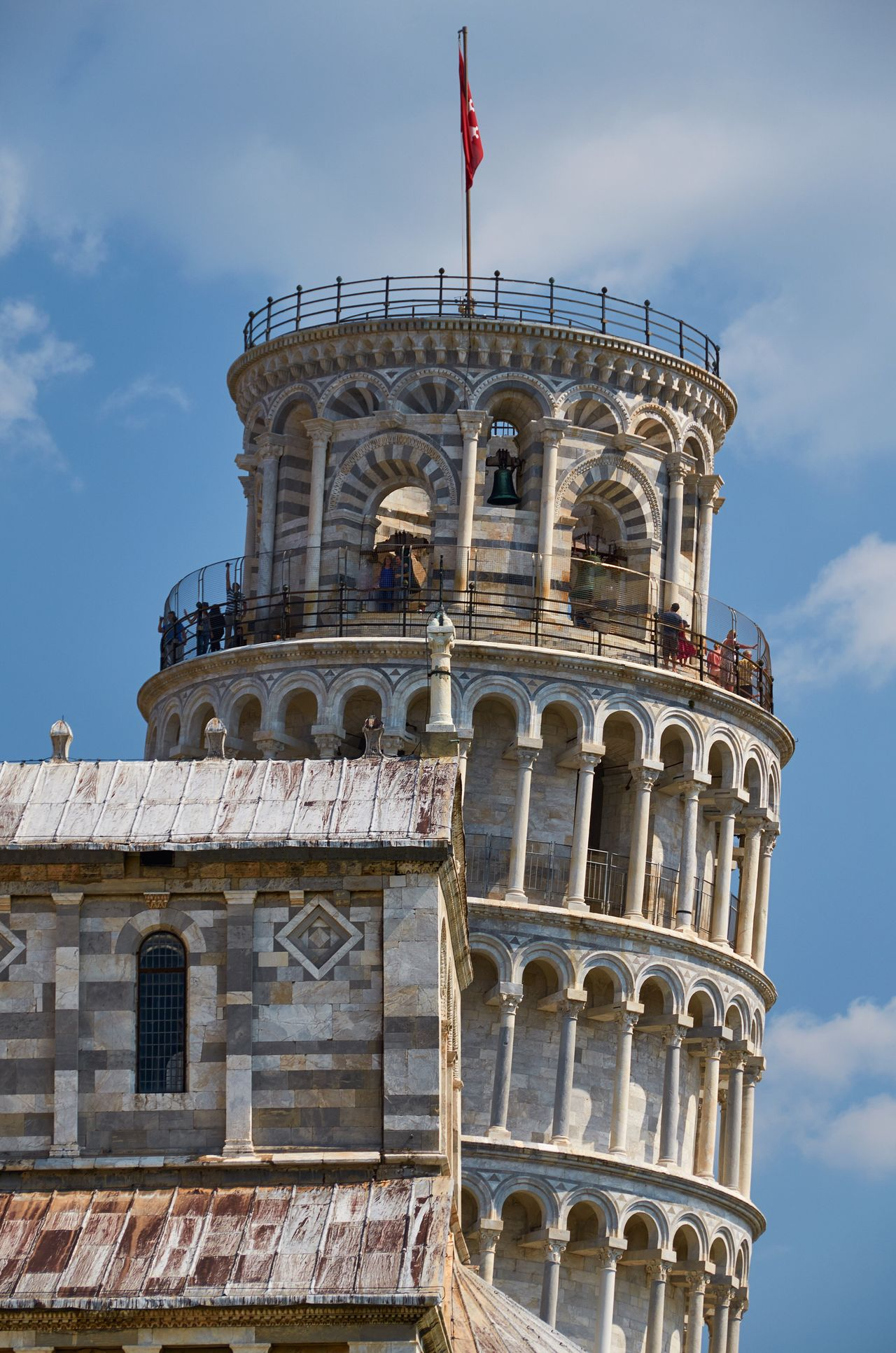 A certain well-known architectural artifact, Pisa Pisa Italy Leaning Tower Of Pisa Tower Architecture Medieval Medieval Architecture Stone Marble World Heritage Landmark Blue Sky Historic Historical Building Built Structure Building Exterior Flag Travel Destinations History Outdoors Church Cathedral Duomo Arch Railing