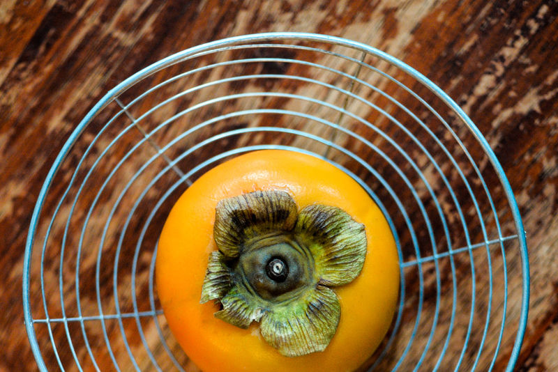 Crafted Beauty Food And Drink Wood Grain Close-up Drainer Food Freshness Fruits Healthy Eating Kitchen Nature Persimmon Still Life Food Stories