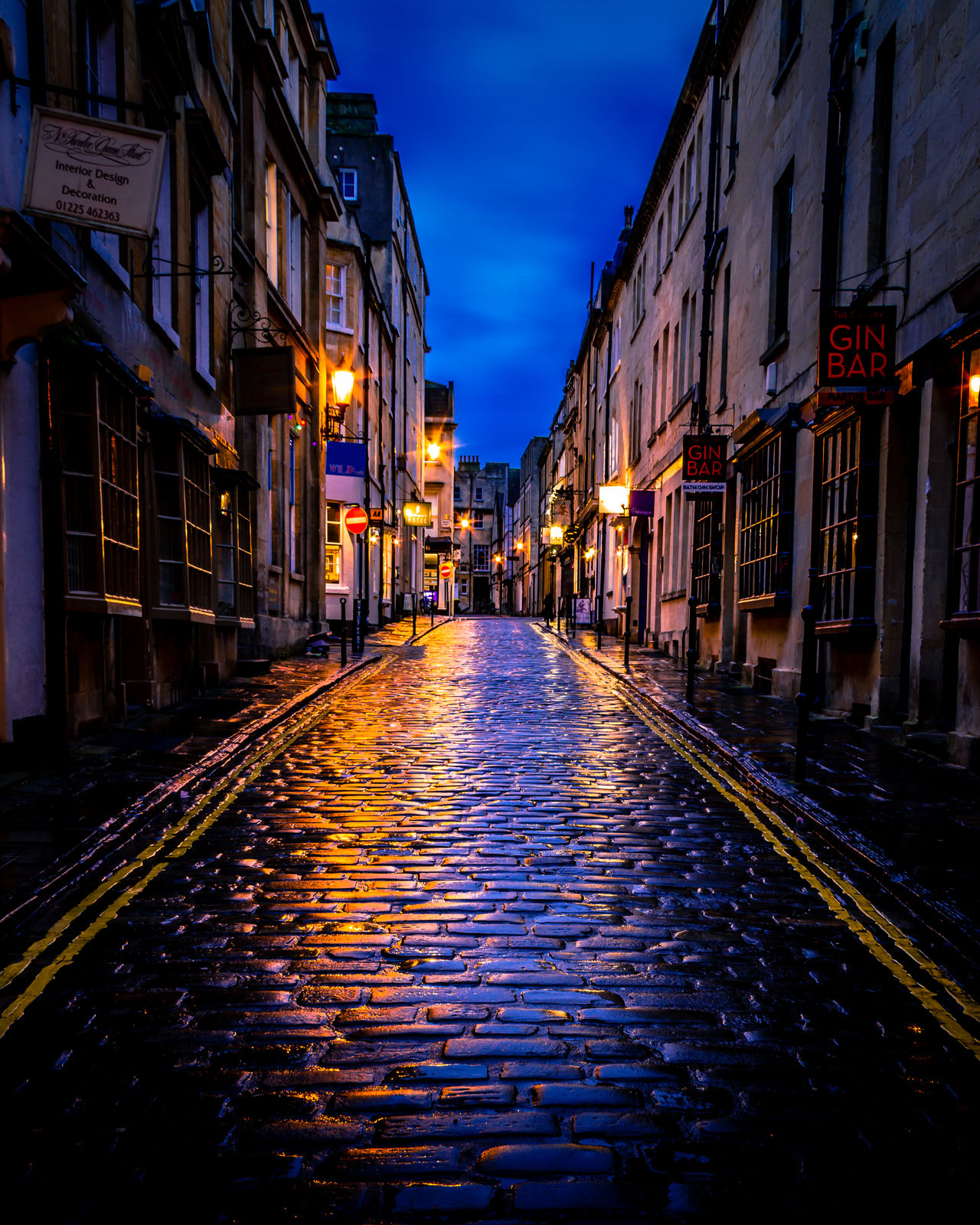 I Wanna Take you to a Gin Bar. The wonderfully crooked, cobbled streets of Bath. This is from the same dull, overcast weekend as my previous photo of Pulteney Weir Architecture Bath Building Exterior Built Structure Cobblestone Cobblestone Streets Cobblestones Illuminated Long Exposure Night Night Photography Nightphotography No People Outdoors Rain Rainy Days Reflection Reflections Sky Street The Way Forward Wet