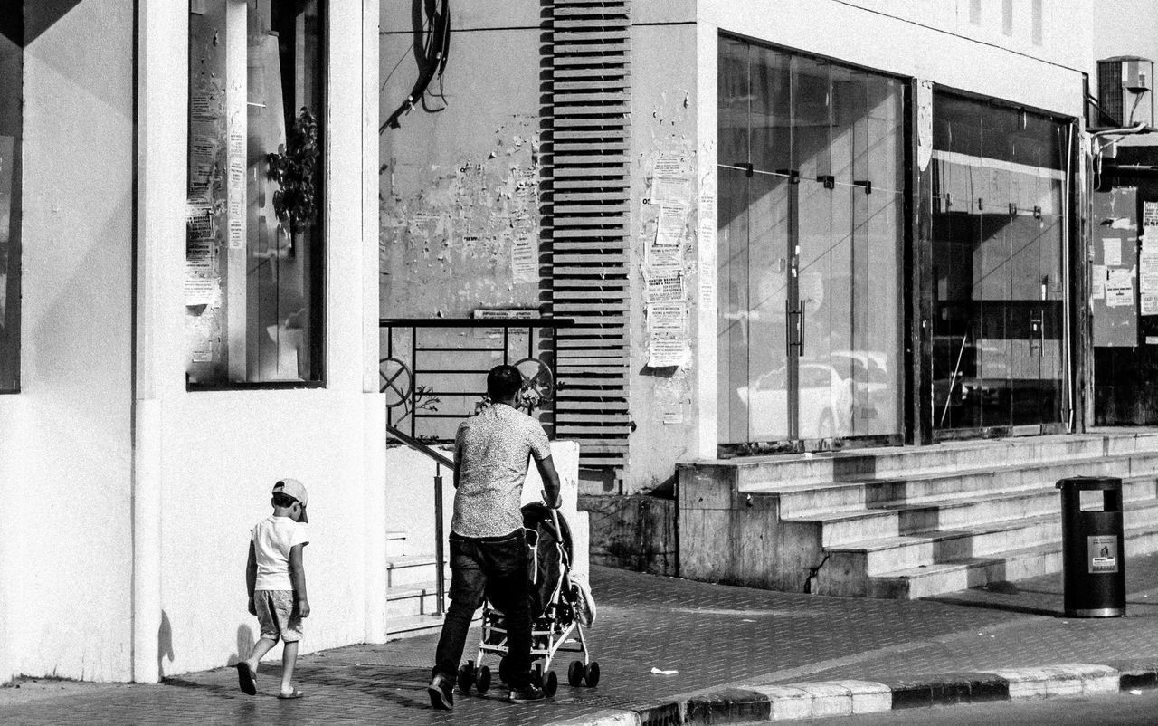 Adult Adults Only Architecture Bicycle Black And White Blackandwhite Building Exterior Built Structure City Day Father And Son Full Length Kid Kids Kids Being Kids Lifestyles Men Outdoors People Popular Popular Photos Real People Senior Adult Two People Women