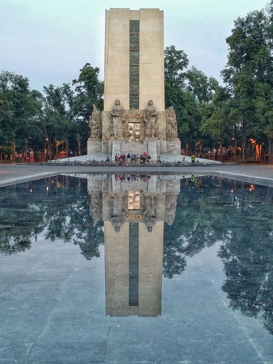Reflection Tree Water Symmetry Sky Built Structure Architecture Travel Destinations Waterfront War Memorial Monument Building Exterior No People Outdoors Day