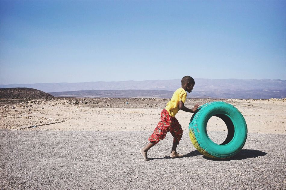 All children have the right to play, regardless of their toys. Lake Assal, Djibouti. February 2016. Documentary