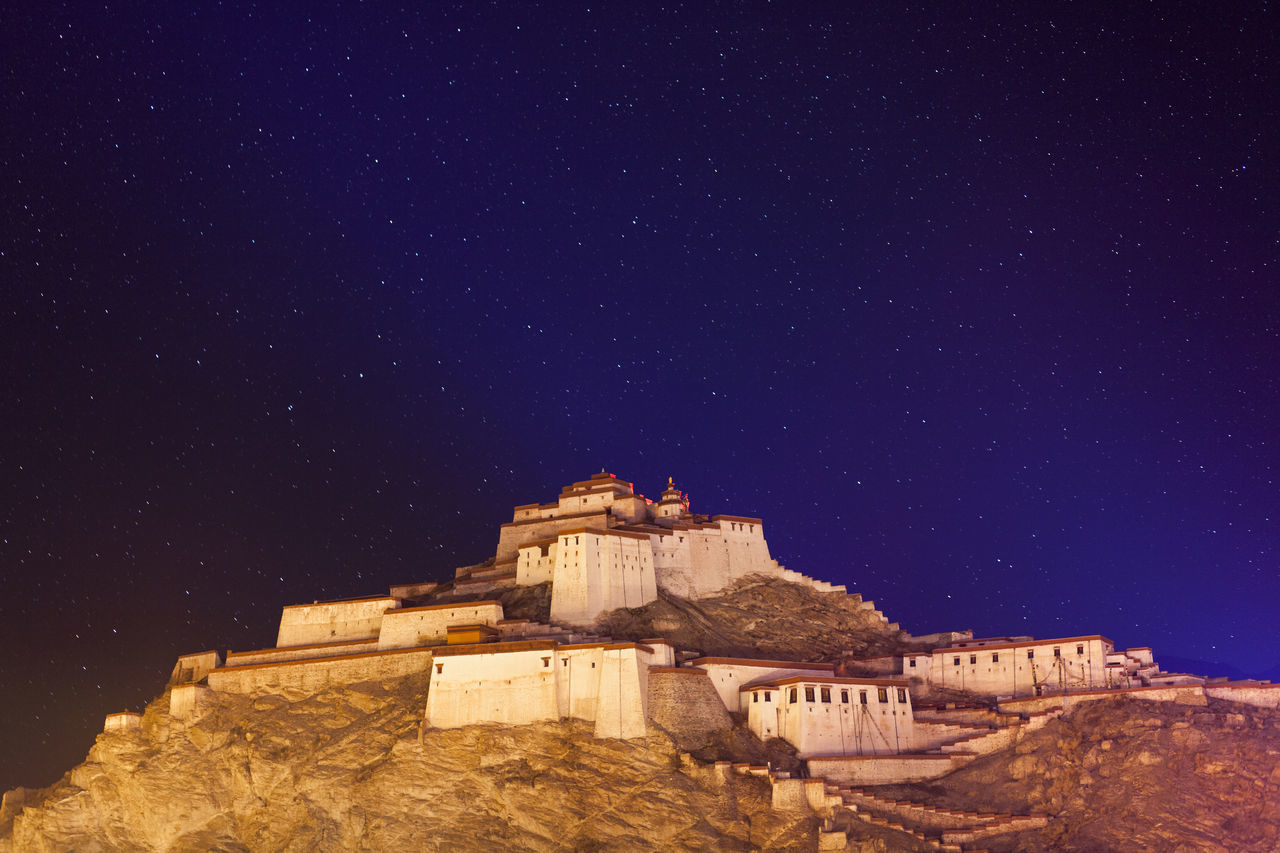 Dzong Hill Ruins under starry night, lies at Dzong Hill at the centre of Gyangtse, Tibet, China. Beauty In Nature Blue China Hill Nature Night Ruined Building Ruins Sky Star Starry Night Tibet