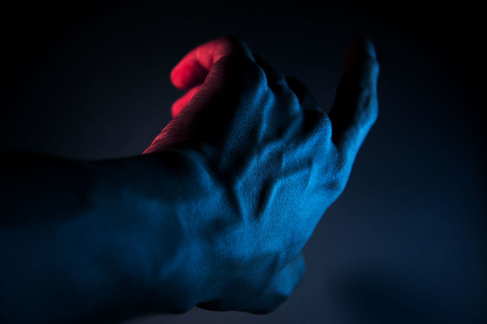 Adult Adults Only Black Background Blue Close-up Human Body Part Human Hand Indoors  One Man Only One Person Only Men People Science Studio Shot Technology Fresh On Market 2017