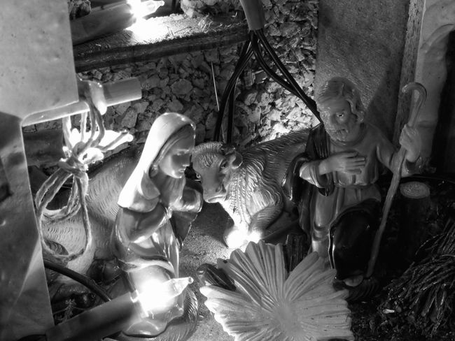 Christmas nativity scene with figurines including Joseph and Mary . Black and white photo Bethlehem Bible Black And White Catholic Celebration Christ Christian Christianity Christmas Creche Family Figurines  God Holiday Jesus Joseph Manger Mary Mother Nativity Peace Religious  Saint Spiritual Virgin Mary