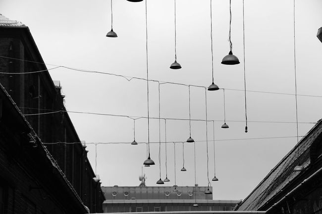 hanging lamps B&w Photography Berlin Electric Lamp Engineering Focus On Foreground Hanging In A Row Industriegebiet Industry Kreuzberg Lamp Lampen Large Group Of Objects Lighting Equipment Low Angle View Metal No People Old Side By Side Street Light Structure Urbanphotography