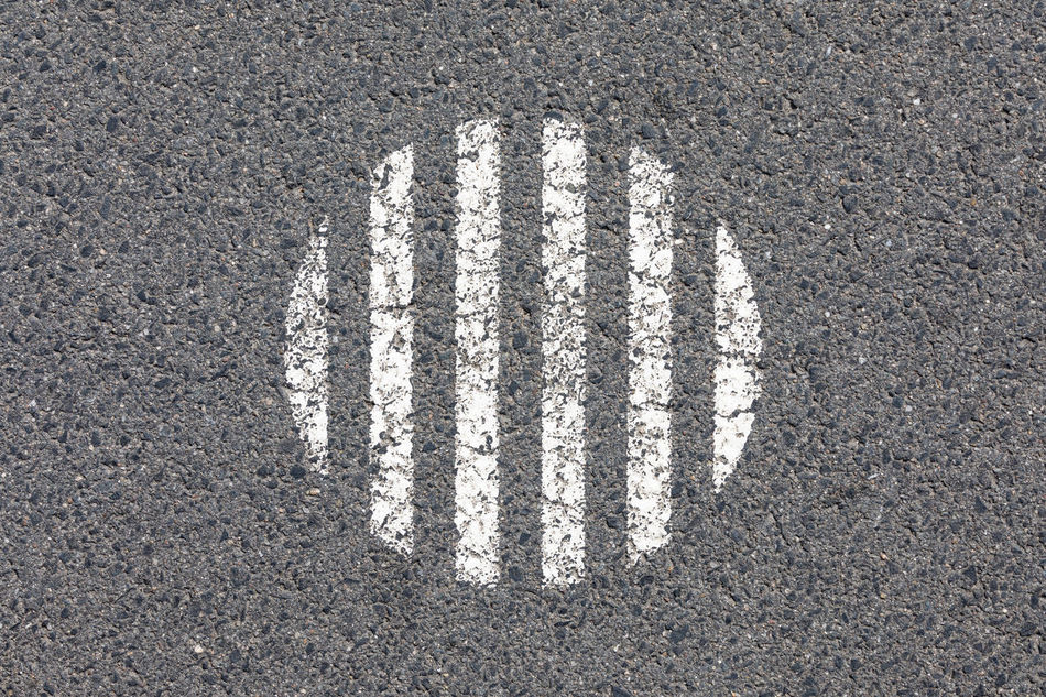 Circle made of white vertical stripes on asphalt road Abstract Asphalt Backgrounds Circle City Close-up Day Directly Above Gray Gray Background High Angle View In The Center No People Outdoors Pattern Repetition Road Road Marking Street Striped Surface Level Symmetry Textured  Vertical White Color
