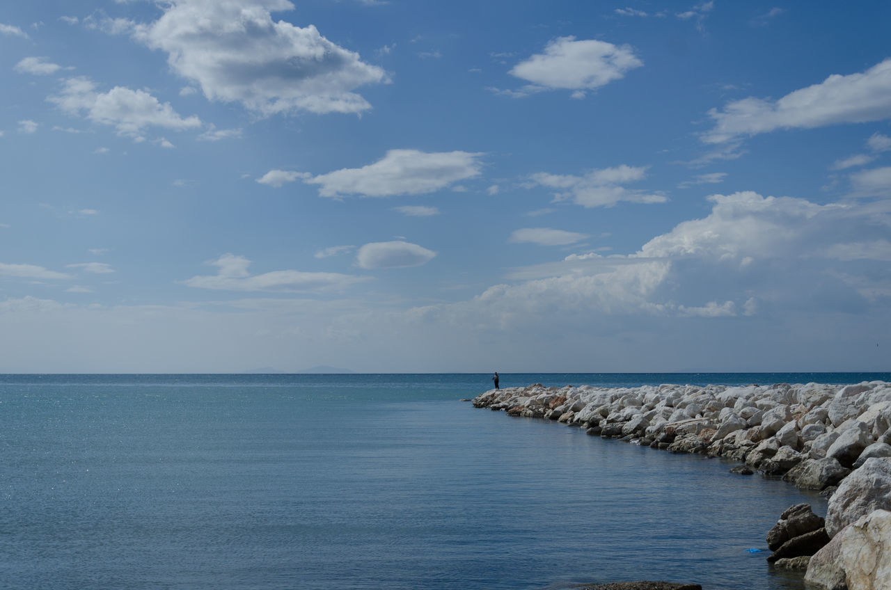 alone mk1 Beach Beauty In Nature Blue Cloud - Sky Day Fisherman Horizon Over Water Idyllic Nature No People Outdoors Rocks Rocks And Water Scenics Sea Sky Tranquil Scene Tranquility Water