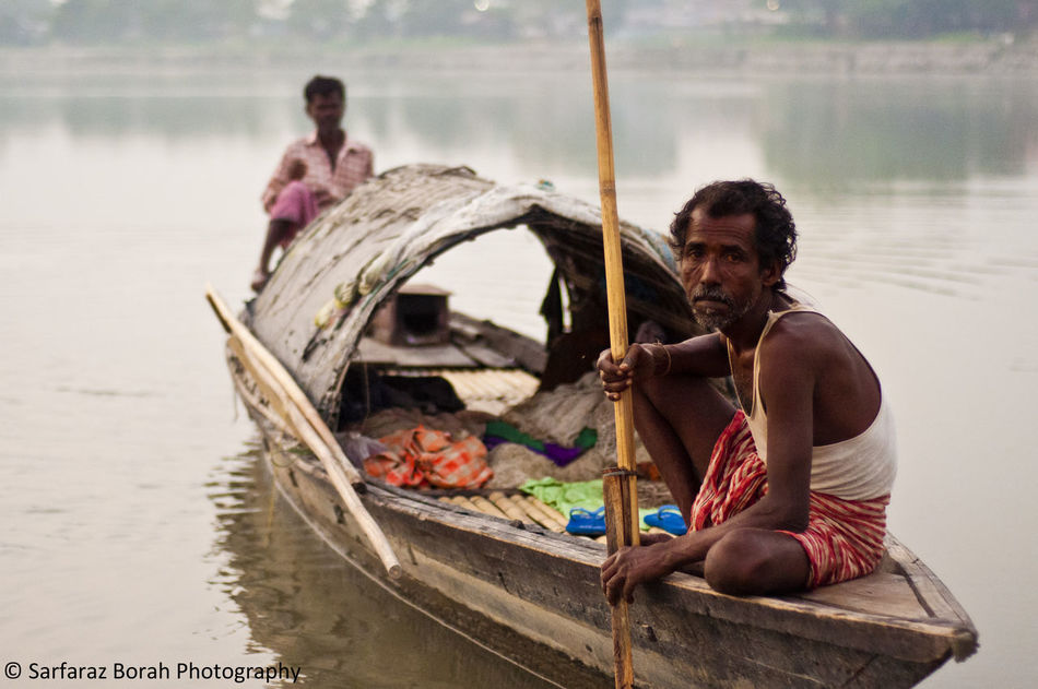 the river runs through their veins. The Mighty Brahmaputra, the only male river in India is a home people like these. They live of the river by fishing, selling those fishes in local markets. This small boat is their home on the river... Brahmaputra Fisherman Fishermen Friendship Happiness House Boat Lifestyles Living Of A Ri Living Of A River Men Only Men People Real People Shirtless Smiling Tezpur Togetherness Transportation Walking Around Water