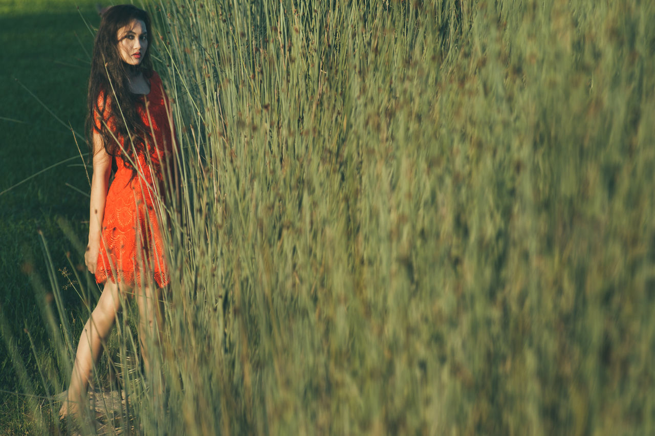 Adult Adults Only Beauty Beauty In Nature Day Dress Full Length Grass Green Color Nature One Person One Woman Only One Young Woman Only Only Women Outdoors People Rain Red Smiling Water Women Young Adult