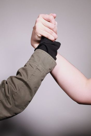 Human Hand Holding Close-up Men Hands Together Brotherhood Brothers Friends Real People Bros Locked Locked Hands Human Body Part Arms Arm Clean Background Blank Background Two People Holding Hands Sleeves Sleeve  Bare Skin Forearm