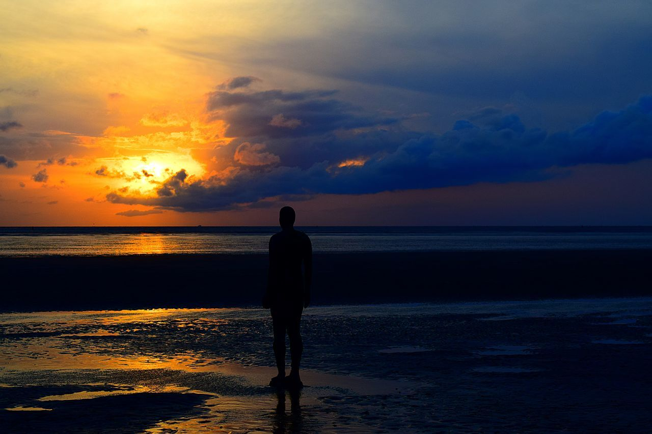 sunset, sea, beauty in nature, horizon over water, beach, water, scenics, sky, nature, silhouette, cloud - sky, tranquil scene, tranquility, idyllic, reflection, one person, full length, real people, rear view, vacations, sun, outdoors, sand, lifestyles, standing, people