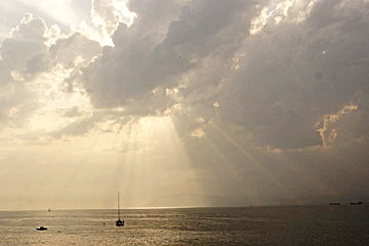 sea, tranquil scene, scenics, horizon over water, beach, tranquility, cloud - sky, water, nature, sky, sunlight, outdoors, sun, sunset, travel destinations, beauty in nature, nautical vessel, awe, day, sailboat, horizon, vacations, no people, sailing ship