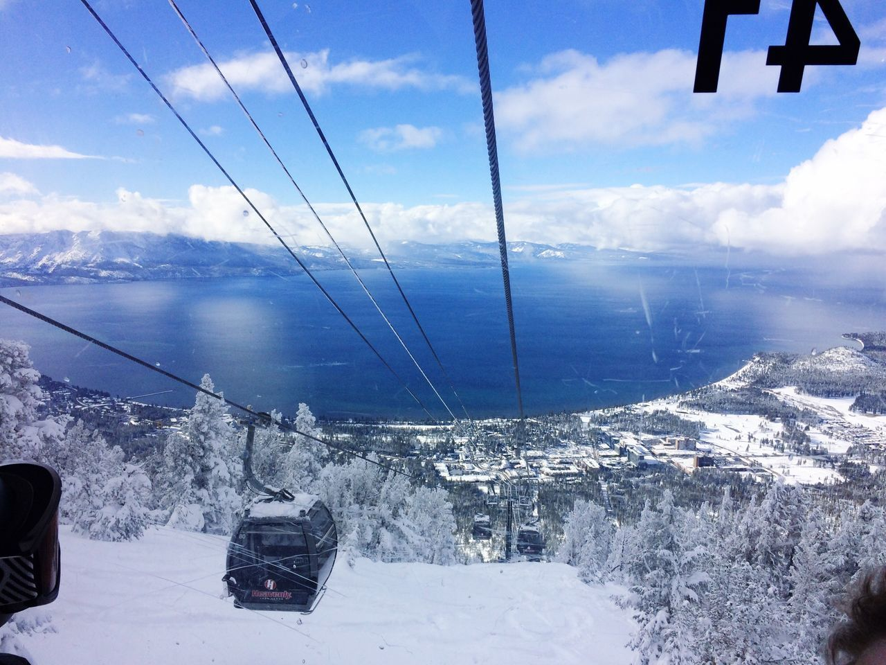 View from gondola through the crackyo/ scratched window to Lake Tahoe Snow Winter Cold Temperature Sky Weather Transportation Mountain Beauty In Nature Mode Of Transport Steel Cable IPhone 5 Photography Sierra Nevada Mountains Blue Sky Outdoors Heavenly Ski Resort
