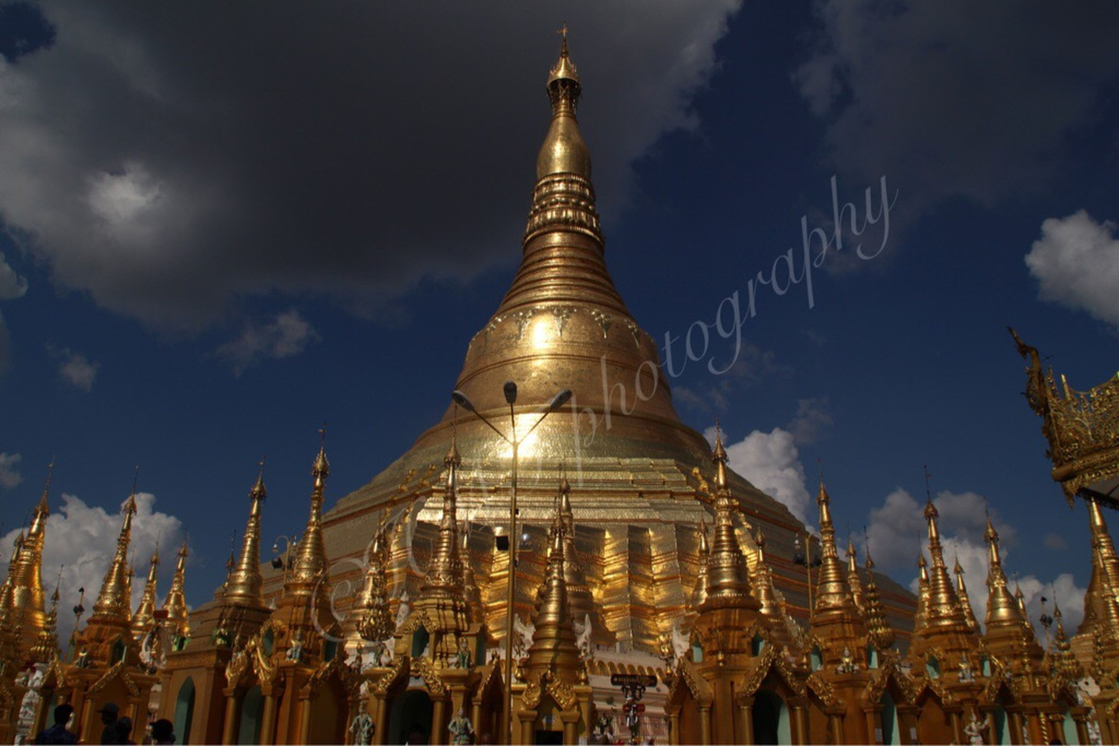 architecture, low angle view, sky, built structure, building exterior, religion, place of worship, famous place, spirituality, travel destinations, cloud - sky, travel, temple - building, tourism, international landmark, history, cloud, outdoors, gold colored