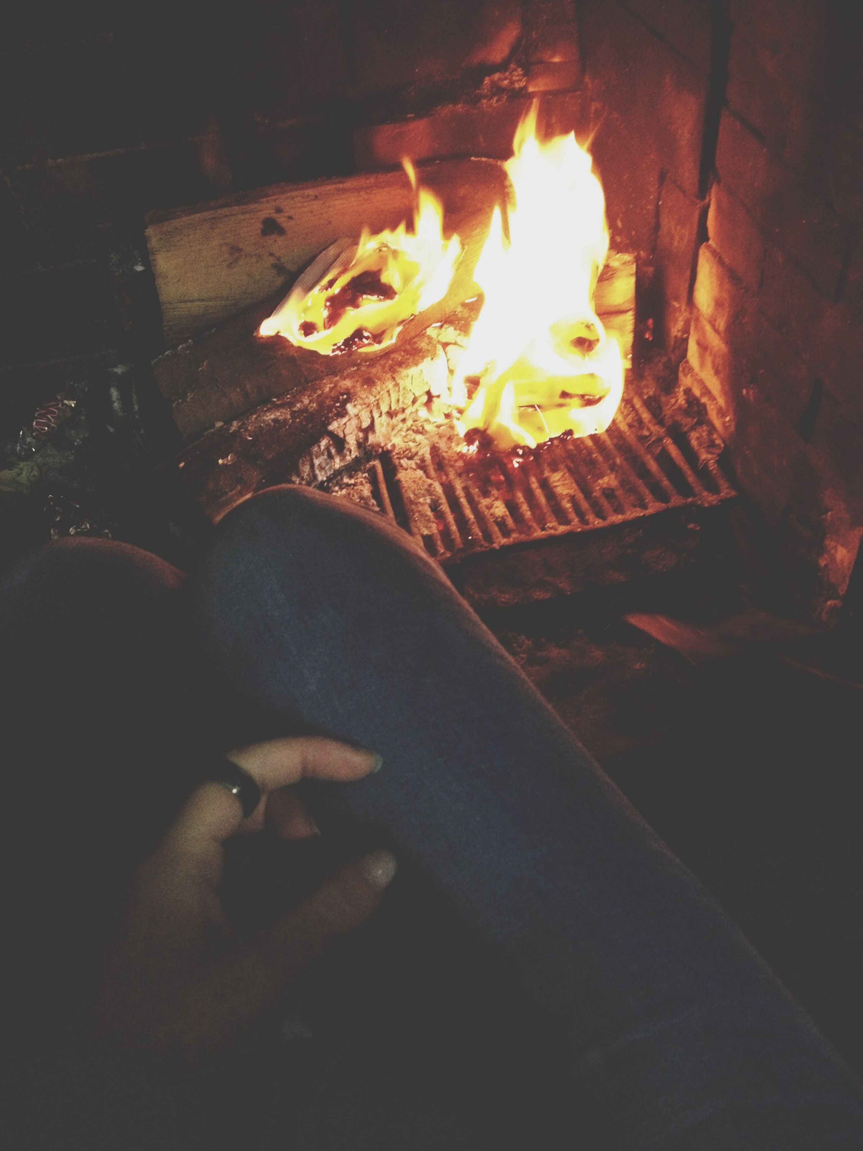burning, flame, fire - natural phenomenon, heat - temperature, glowing, night, indoors, fire, high angle view, wood - material, bonfire, illuminated, firewood, orange color, candle, heat, dark, close-up, light - natural phenomenon, fireplace