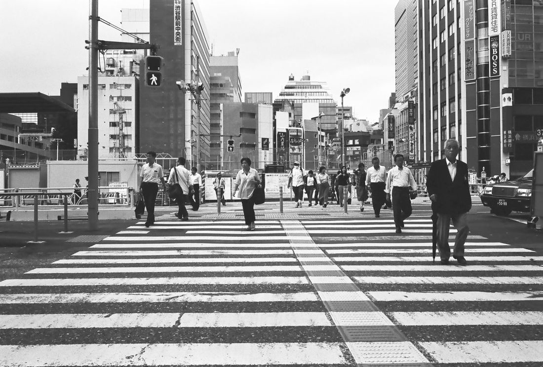 Crossing Adult Adults Only Architecture Building Exterior Built Structure City City Life City Street Crosswalk Day Downtown District Japan Large Group Of People Men Outdoors Pedestrian People Real People Skyscraper Tokyo Street Photography Walking Women