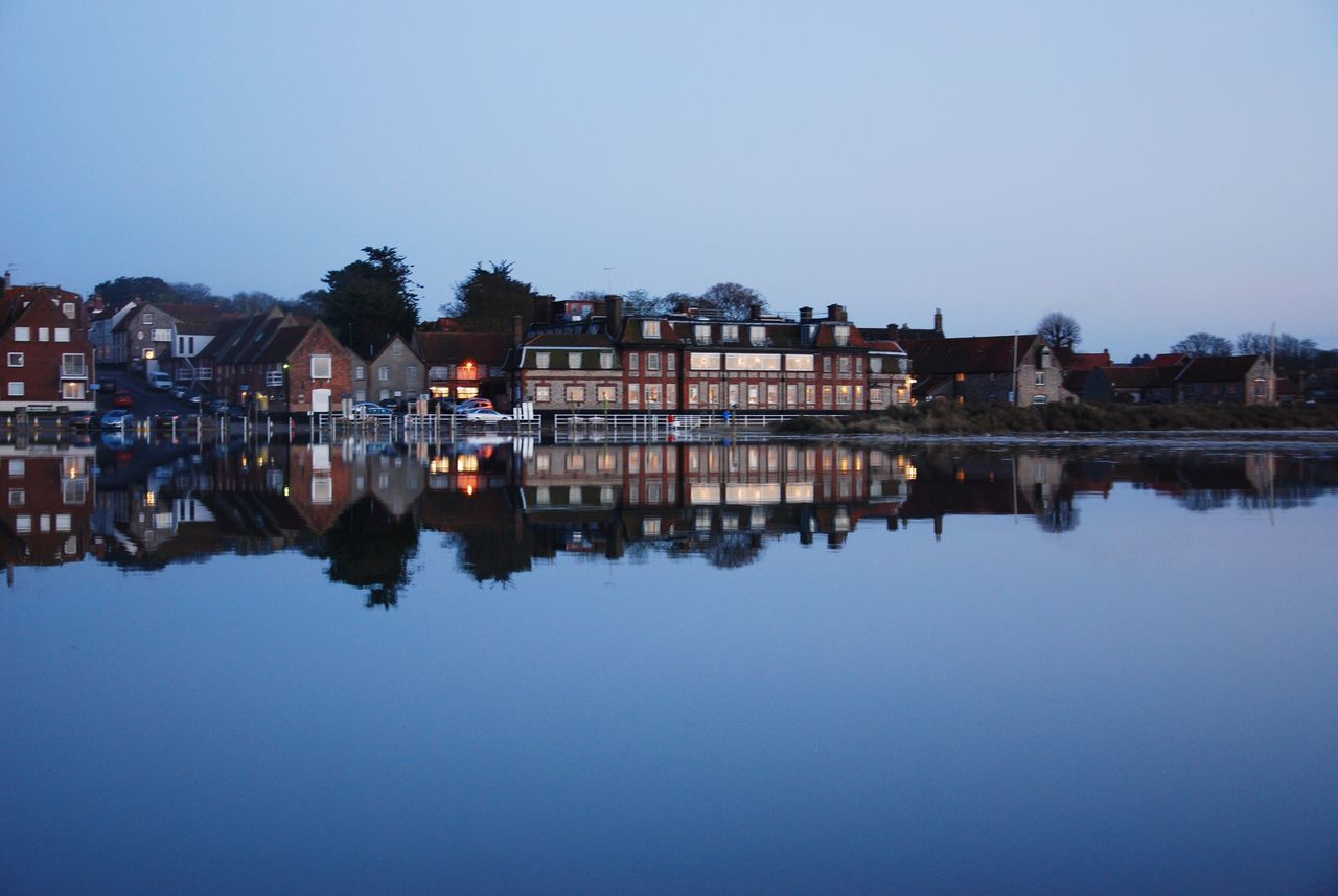 Blakeney Hotel Reflection Water Architecture Built Structure Waterfront Building Exterior Clear Sky Nature Tree Symmetry Outdoors Standing Water Beauty In Nature No People City Sky Day