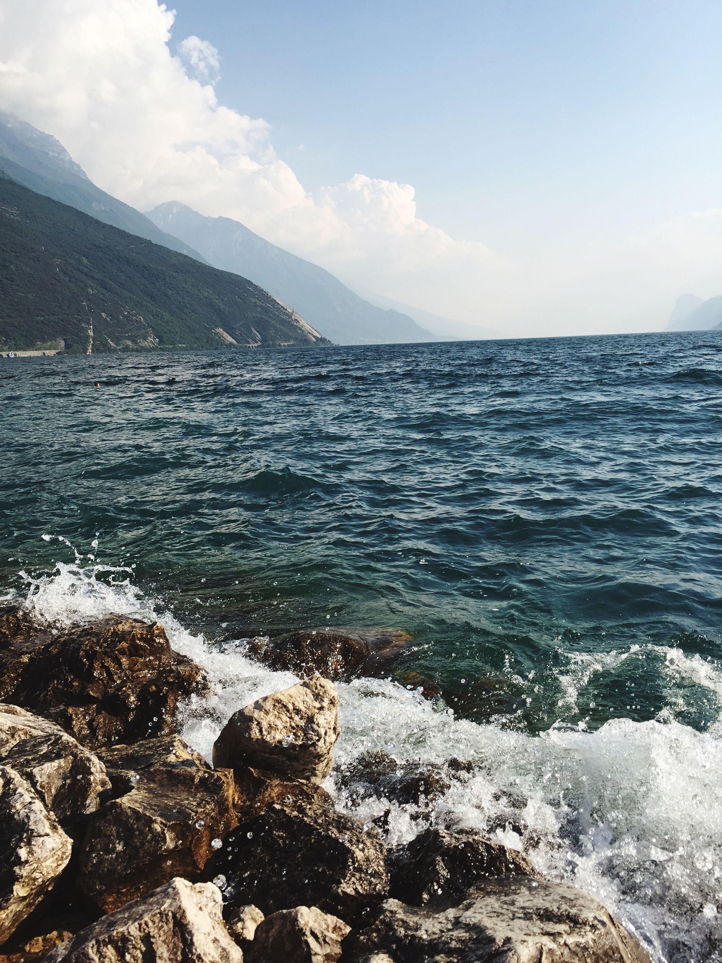 water, sea, scenics, tranquil scene, beauty in nature, tranquility, sky, nature, horizon over water, beach, shore, rock - object, idyllic, wave, mountain, coastline, remote, non-urban scene, surf, rippled